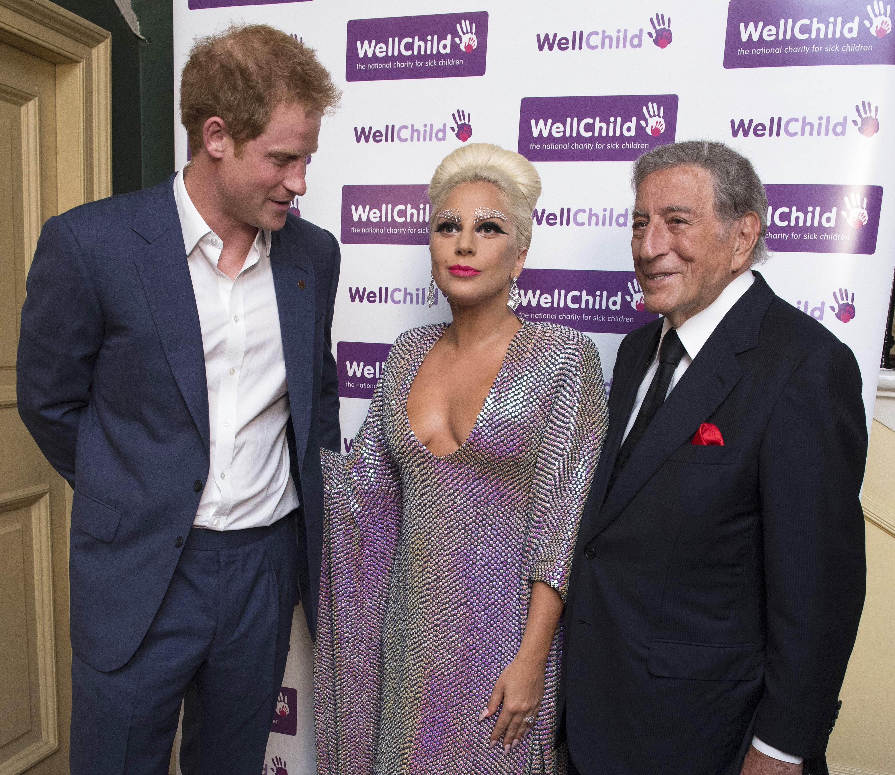 [9:16] Britain's Prince Harry (L) stands with performers Lady Gaga and Tony Bennett before a Well Child charity concert at the Royal Albert Hall