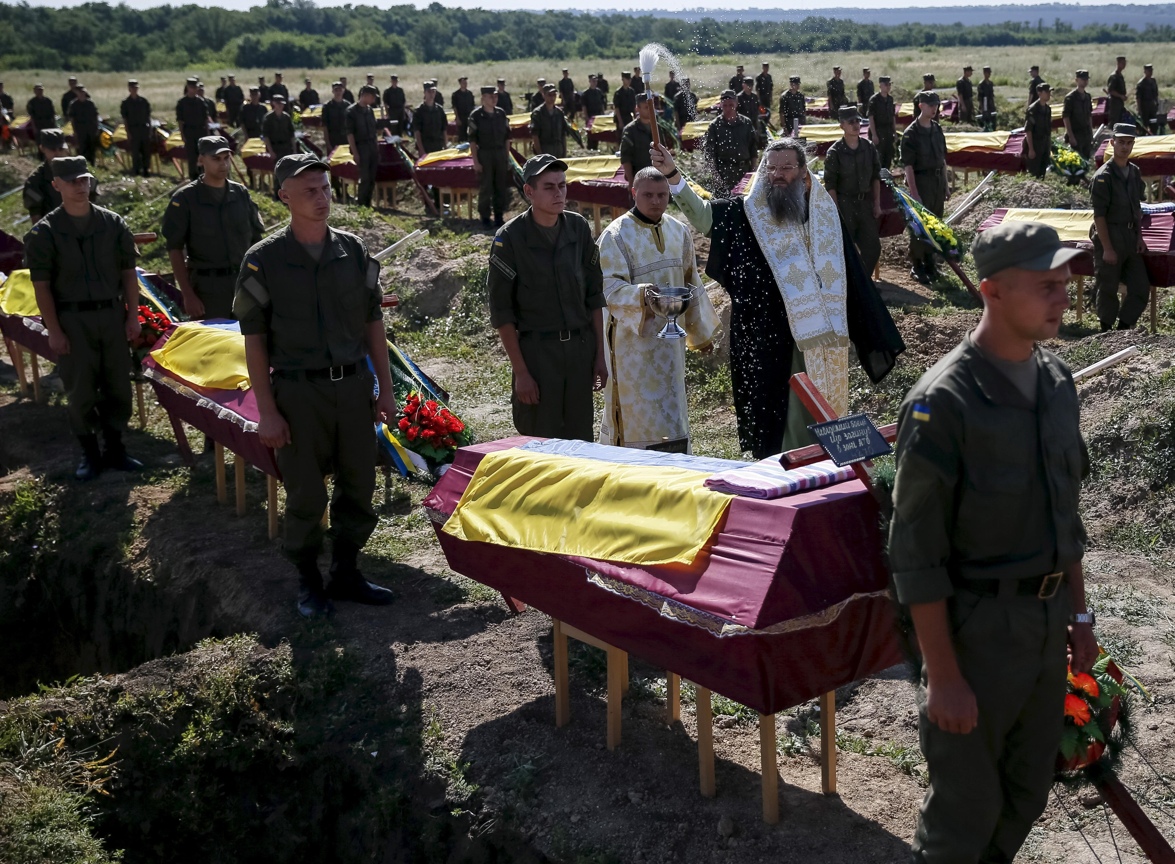 Unidentified soldiers are buried in Ukraine.