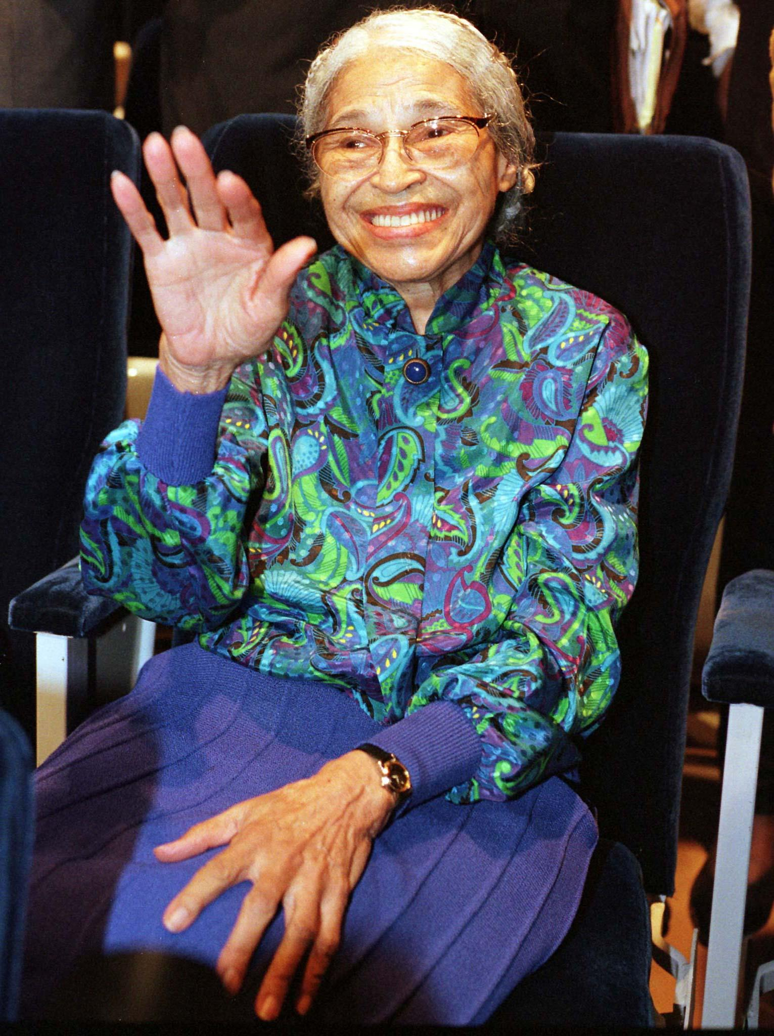 Rosa Parks waves during an event in 1998.