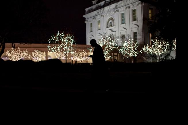 Obama silhouetted walking t the oval office dec 2010 -- pete souza