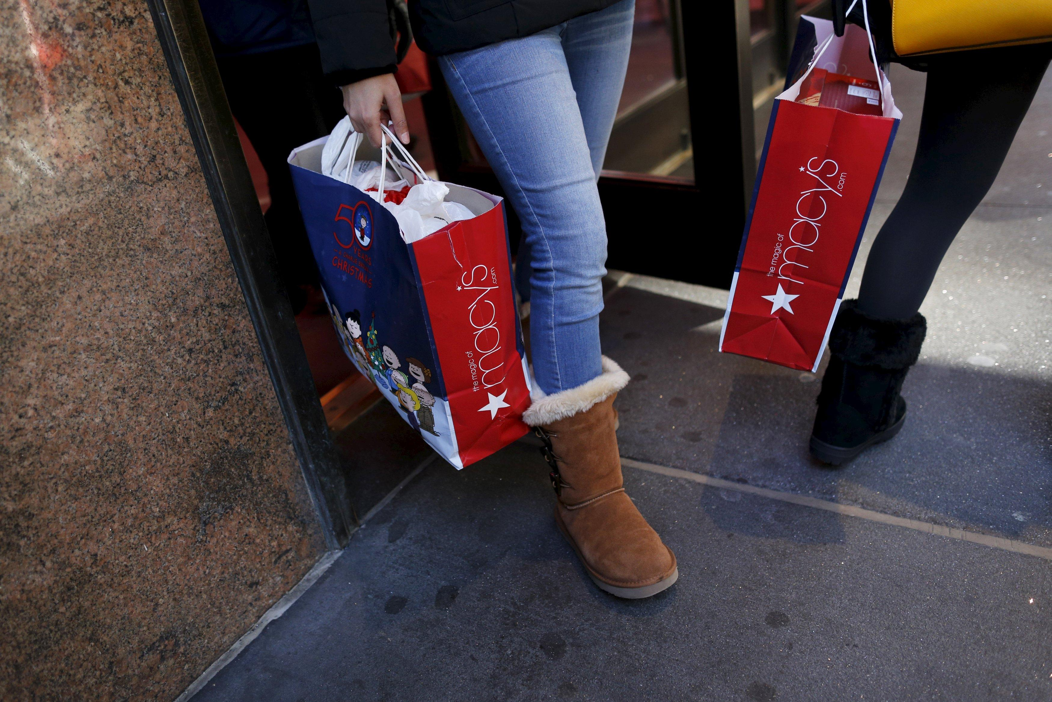 Shoppers exit Macy's on 34th St. in Herald Square in the Manhattan borough of New York