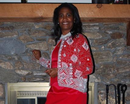 CLEASTER COTTON © 2013 - Cheryl Johnson poses in front of her fireplace @ her and Gene's Party