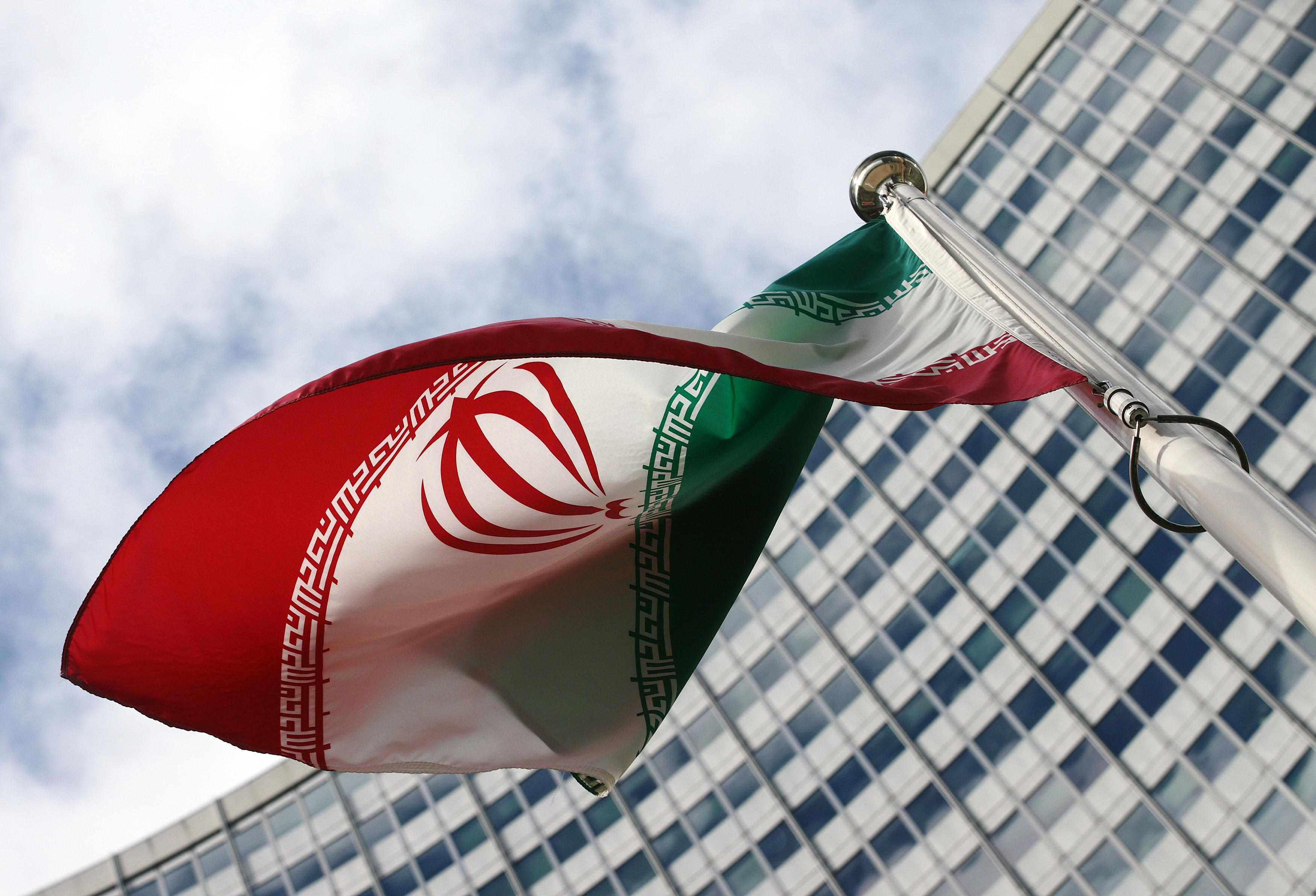 An Iranian flag outside of the UN building in Vienna.