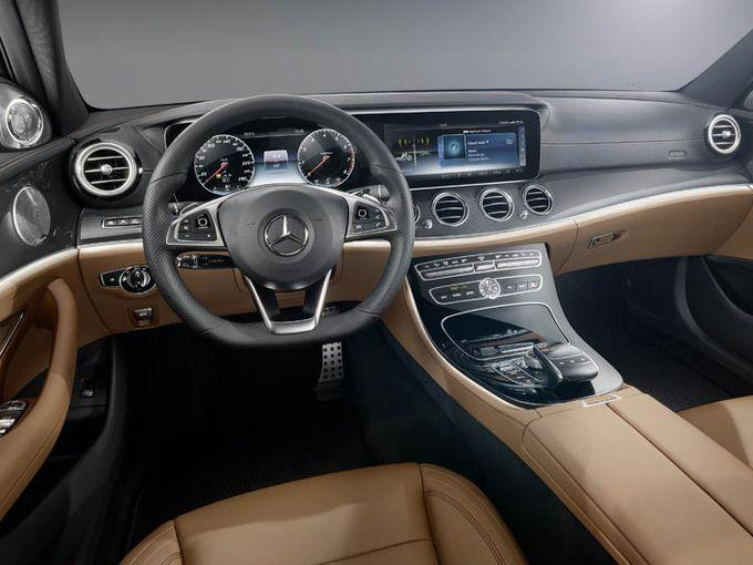 The 2017 Mercedes E-Class has a high-tech center console and an analog  clock, a nod to the automaker's classic sensibilities. Photo: Mercedes-Benz