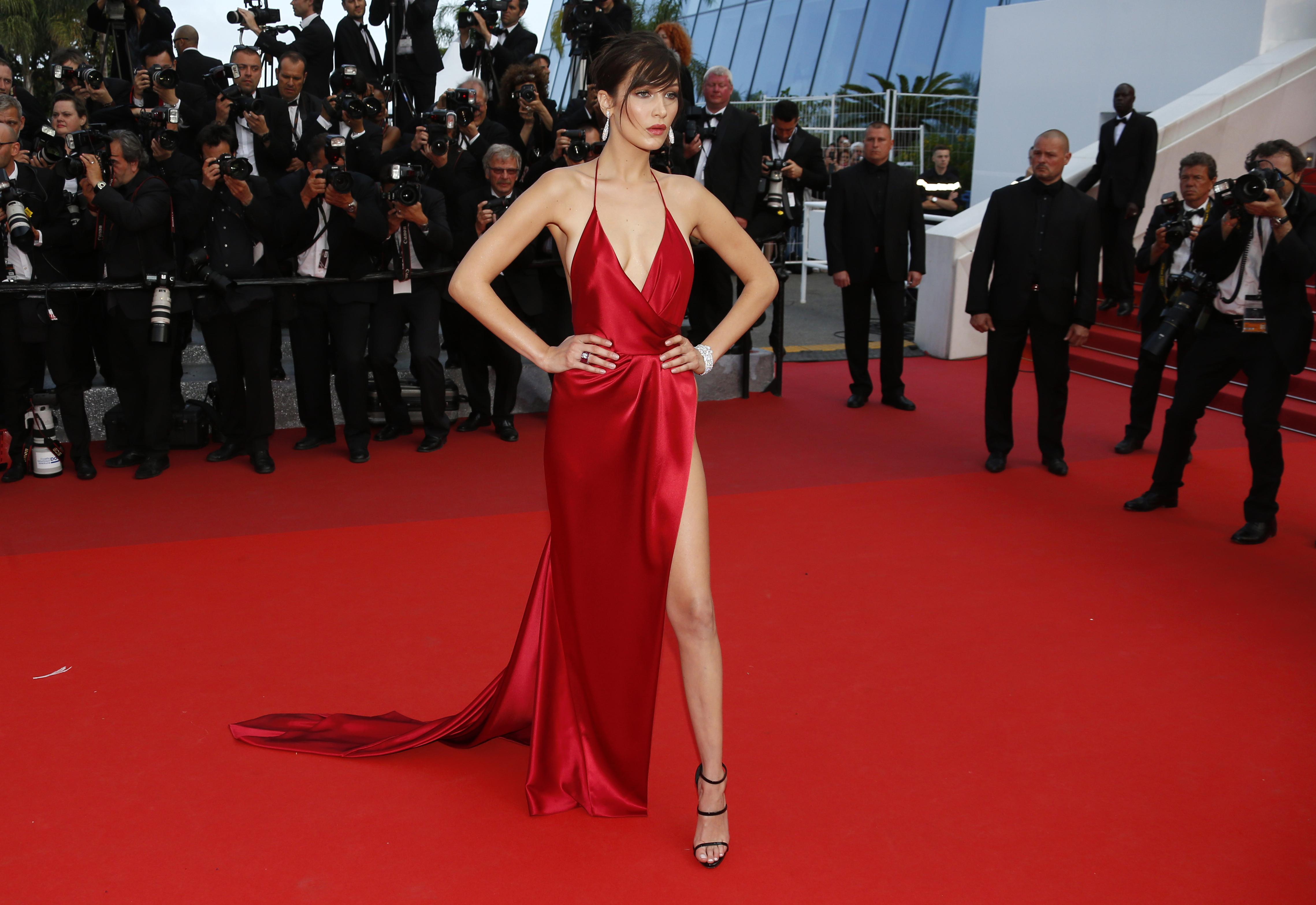 Model Bella Hadid poses on the red carpet at the 69th Cannes Film Festival