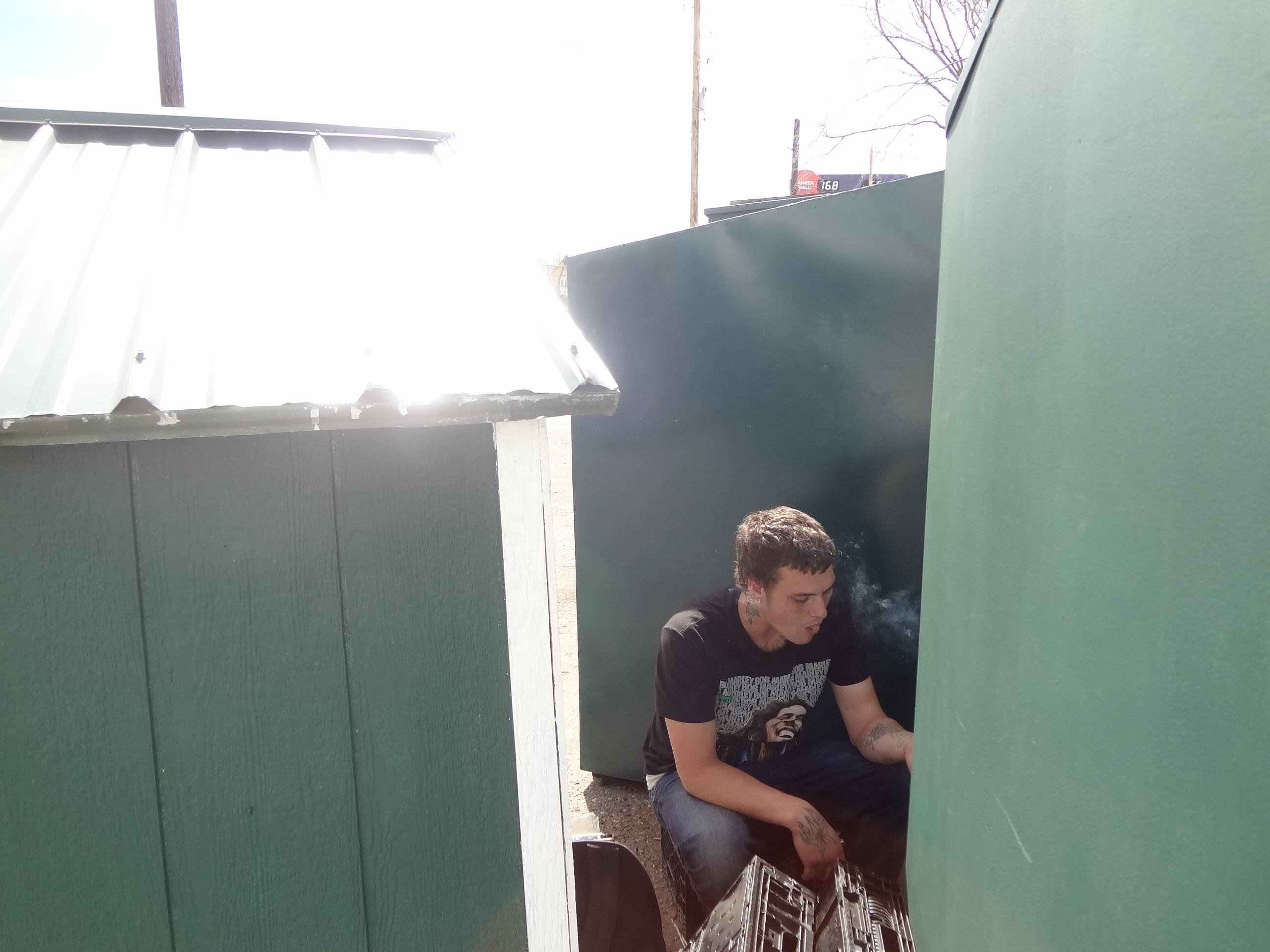 Devin Butts among the dumpsters