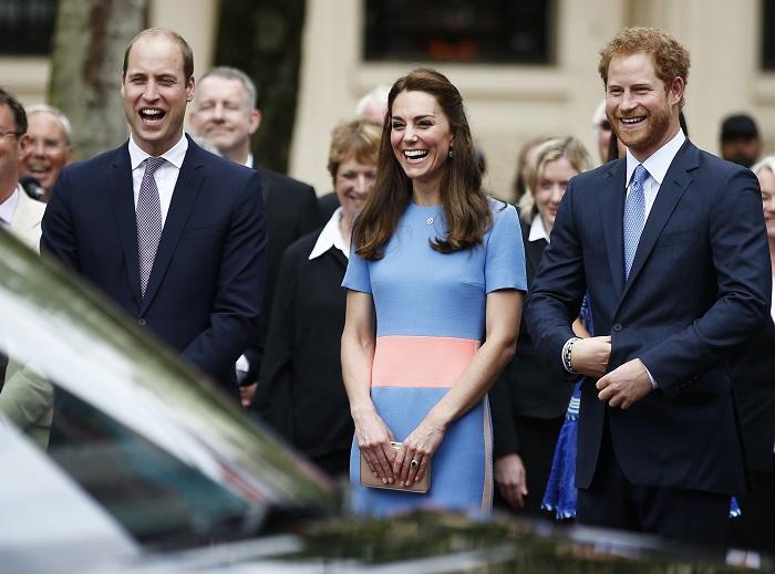 Prince William, the Duchess of Cambridge and Prince Harry (R)
