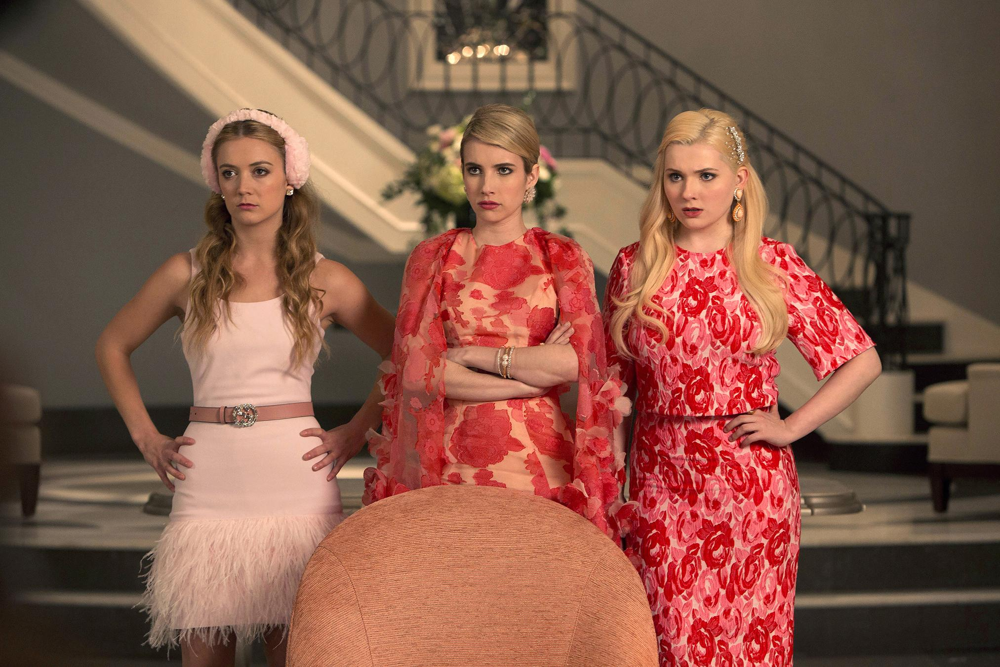 Billie Lourd as Chanel #3, Emma Roberts as Chanel Oberlin and Abigail Breslin as Chanel #5