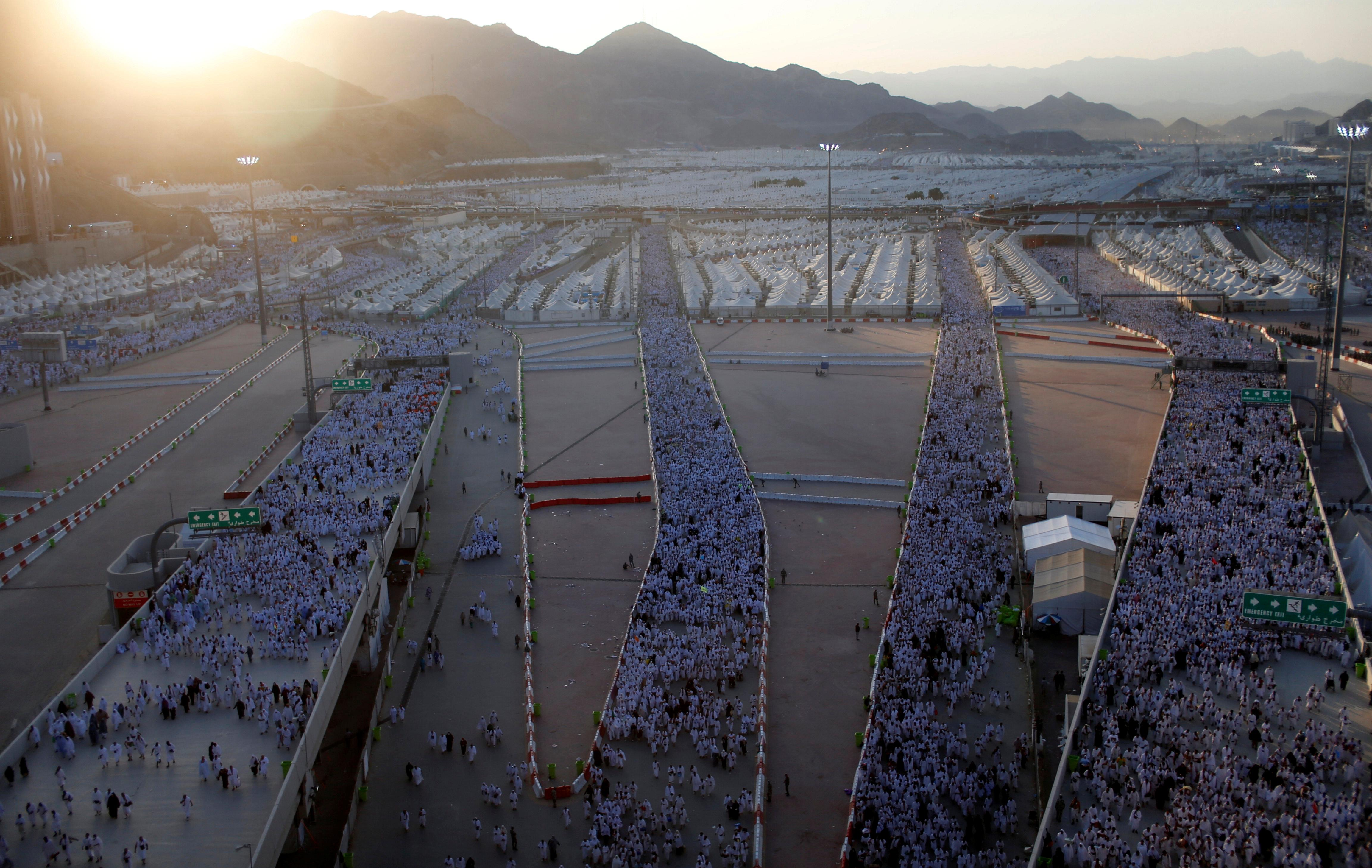 Muslim pilgrims walk on roads as they head to cast stones at pillars symbolizing Satan during the annual hajj pilgrimage in Mina on the first day of Eid al-Adha, near the holy city of Mecca, Saudi Arabia Sept. 12, 2016. Photo: REUTERS/Ahmed Jadallah TPX IMAGES OF THE DAY