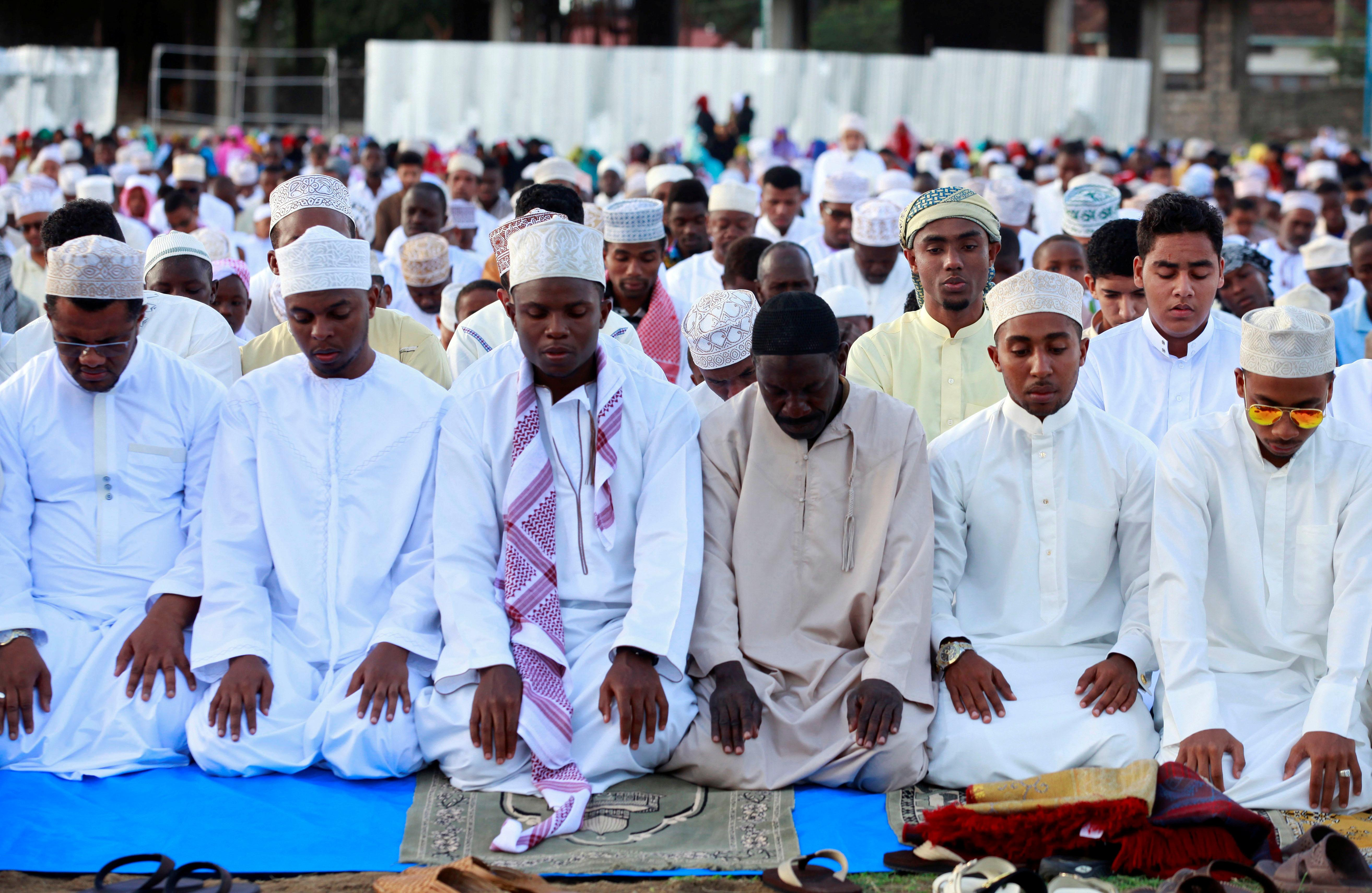 Muslims attend an Eid al-Adha mass prayer marking the end of the annual Hajj pilgrimage, in Mombasa, Kenya