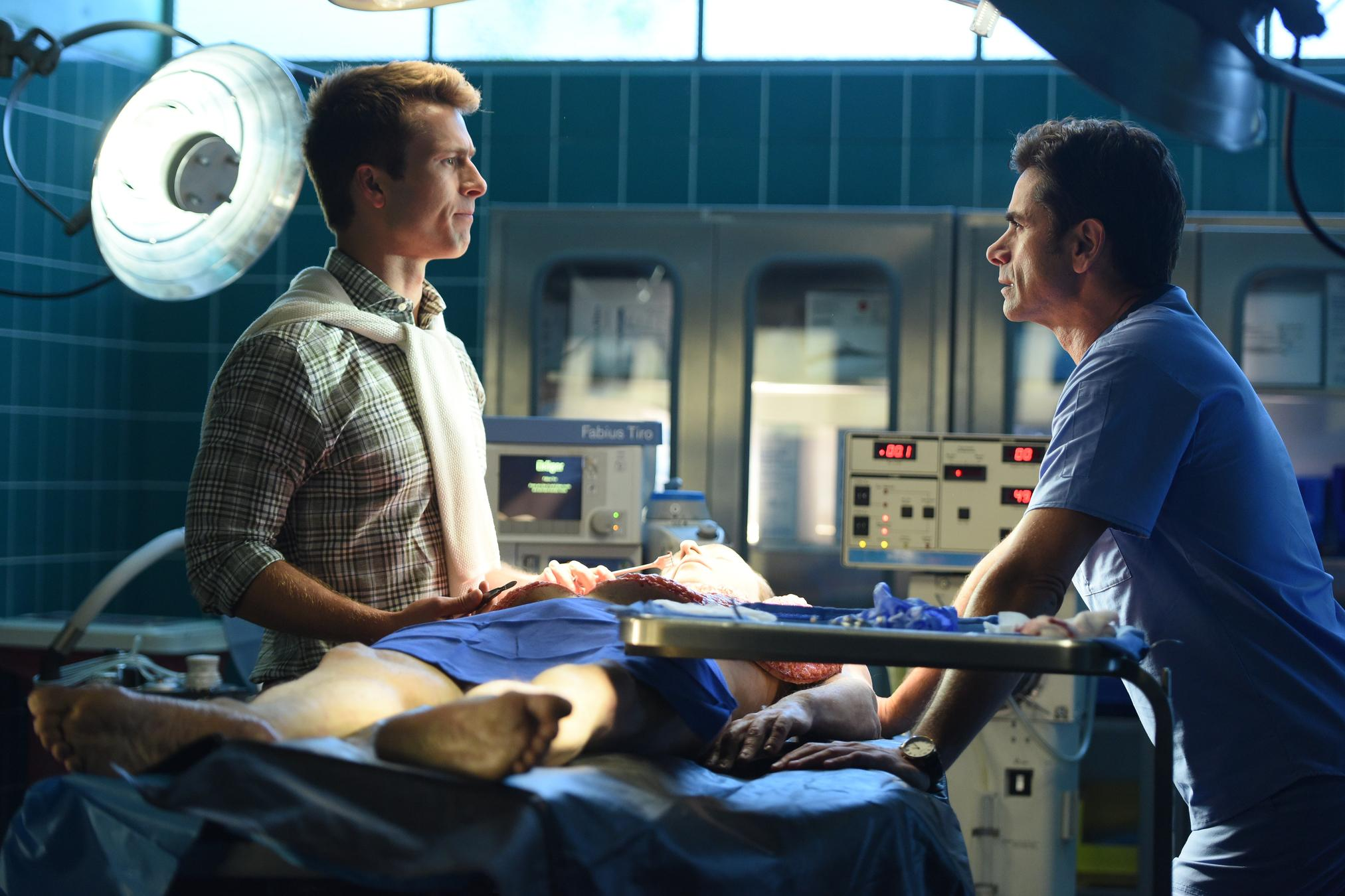 Glen Powell as Chad Radwell, John Stamos as Dr. Brock Holt