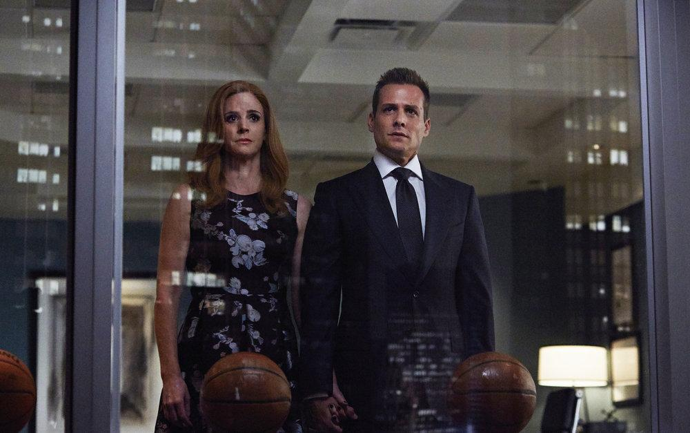 Sarah Rafferty as Donna Paulson and Gabriel Macht as Harvey Specter