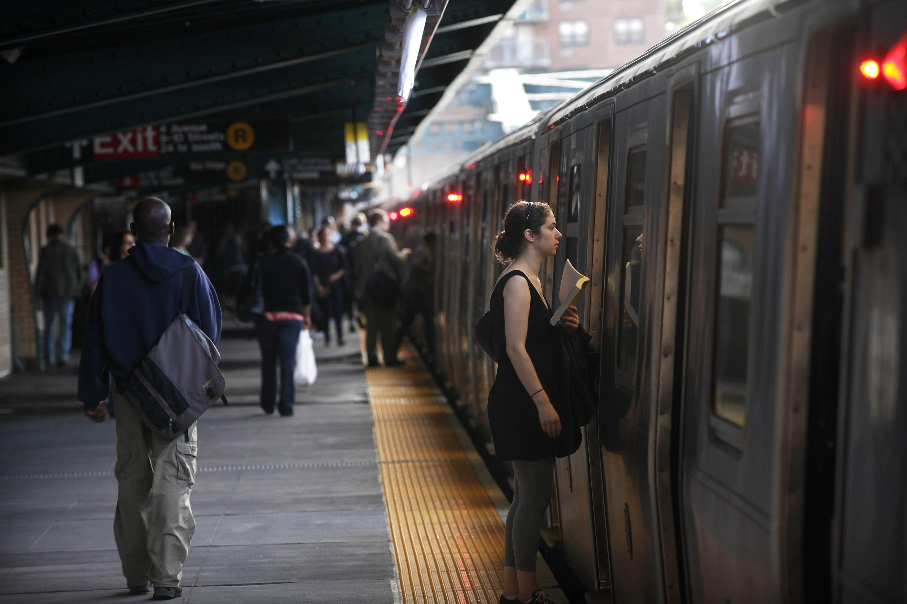 Woman rescued from underneath subway train