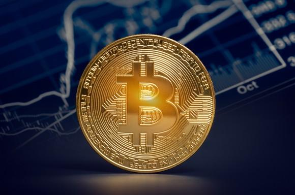 shiny-gold-bitcoin-with-market-graph-background_large