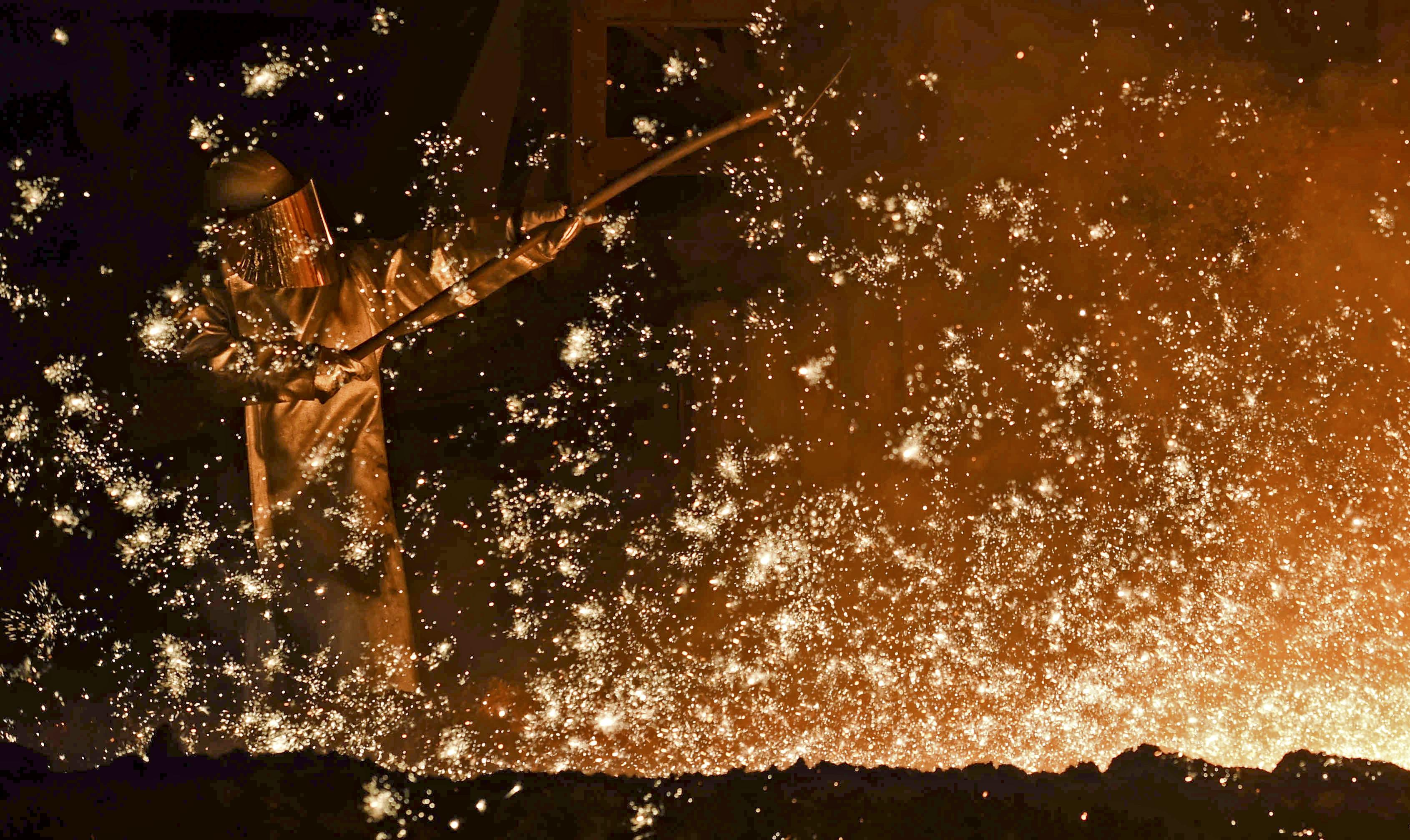 A German steel-worker at a furnace