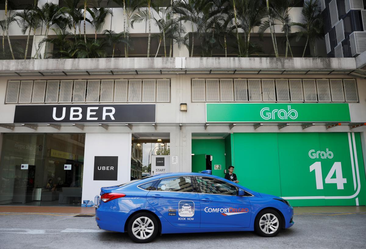 Uber Bows To Grab Sells Southeast Asia Business To Rival