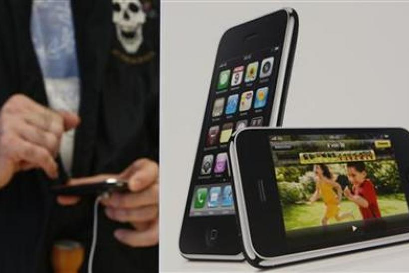 A customer tries out the new iPhone 3GS at the Apple Store in Zurich