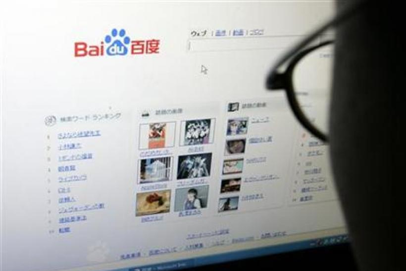 An employee looks at Chinese Web search leader Baidu.com Inc's new Japanese Web search engine in Tokyo