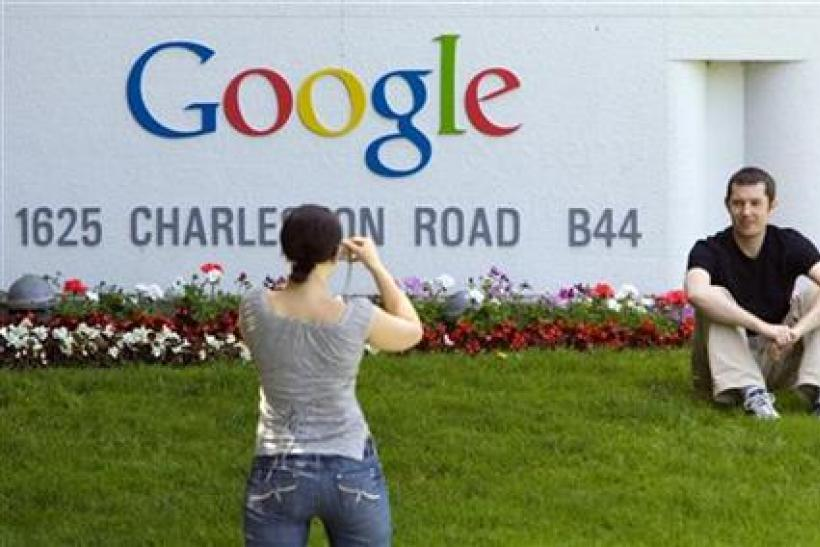 Man has his picture taken in front of Google Inc. headquarters in Mountain View