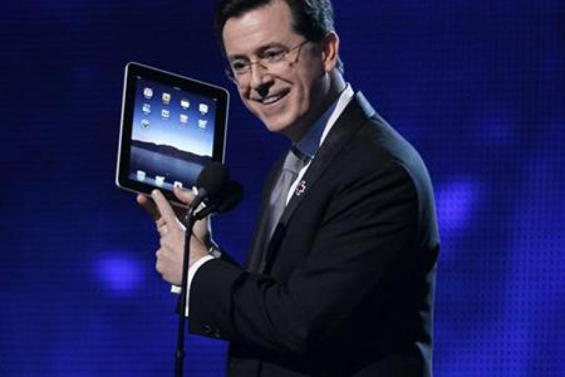 Stephen Colbert opens the show holding an Apple iPad at the 52nd annual Grammy Awards in Los Angeles