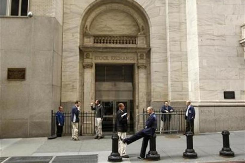 Traders smoke cigarettes outside the New York Stock Exchange