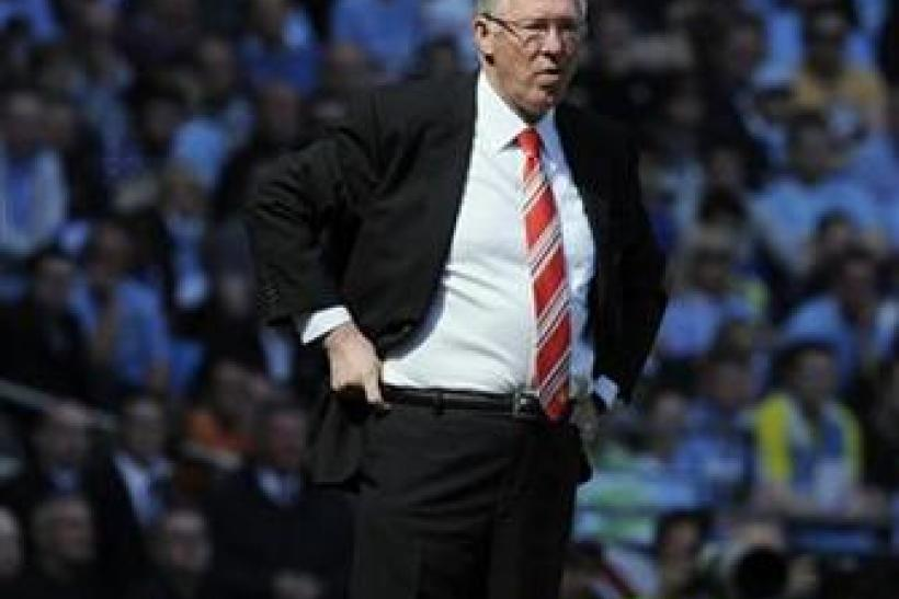 Manchester United's manager Ferguson watches from the touchline during their English Premier League soccer match against Manchester City in Manchester