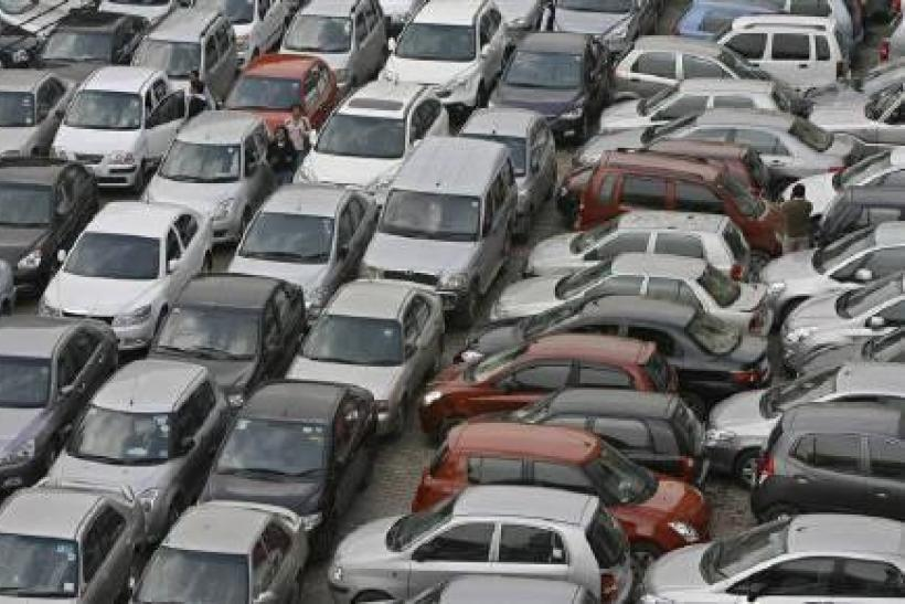 Vehicles are seen at a parking lot in New Delhi February 9, 2010.