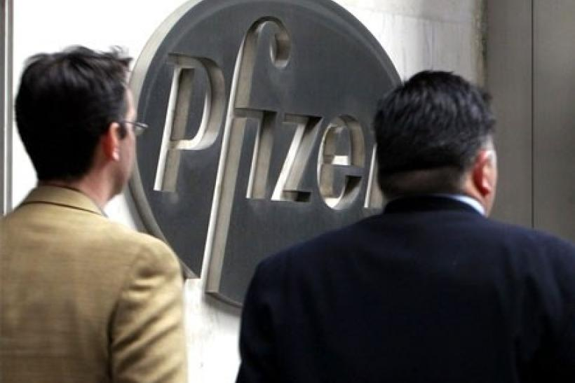 People walk past the Pfizer World headquaters in New York, February 3, 2010