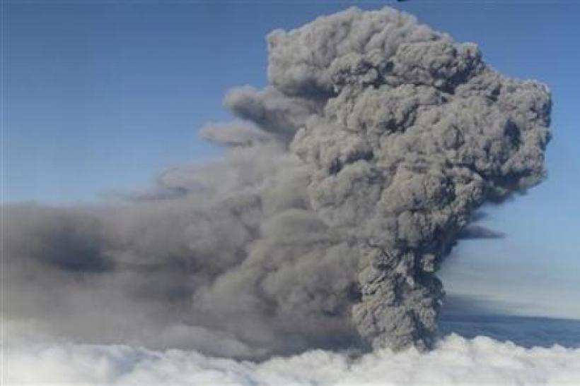 An ash plume rises from a volcano