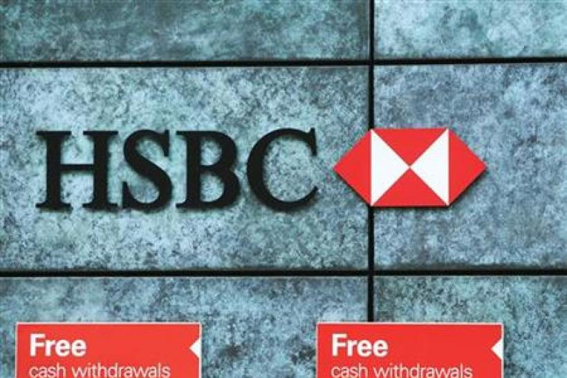 Free cash withdrawals are advertised outside a HSBC bank in the city of London