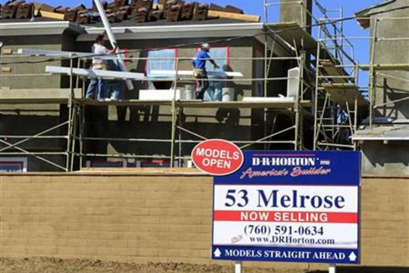 Construction workers continue work on a new subdivision of homes