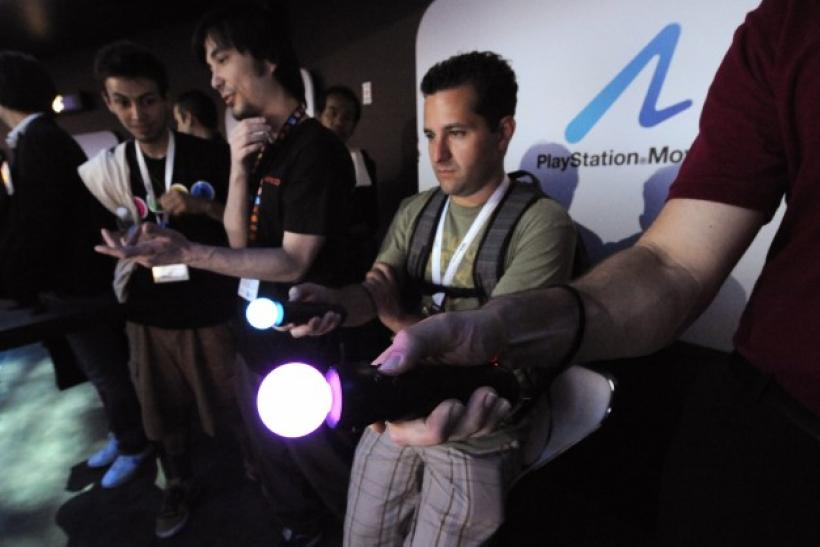 Attendees try out the Sony PlayStation 3 at the E3 Media & Business Summit in Los Angeles.
