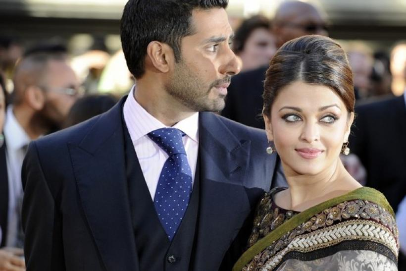 Married Bollywood couple Abishek Bachchan (L) and Aishwayra Rai Bachchan arrive for the world premiere of their film 'Raavan' at the BFI in London, June 16, 2010.