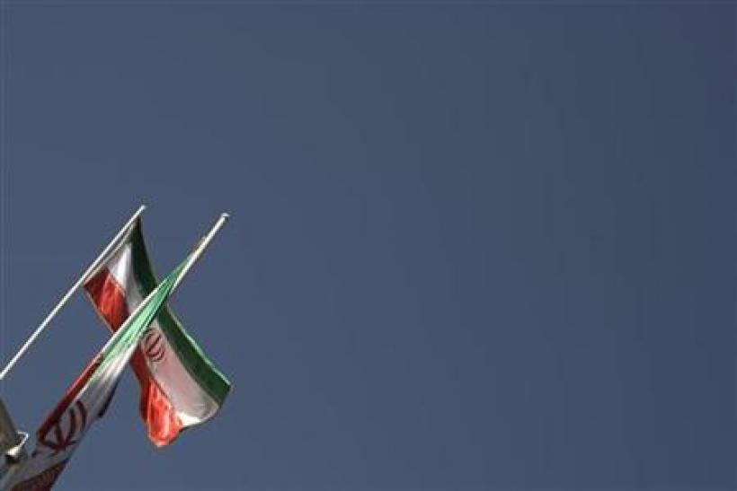 Iranian flags are pictured on the roof of the presidential office in Tehran