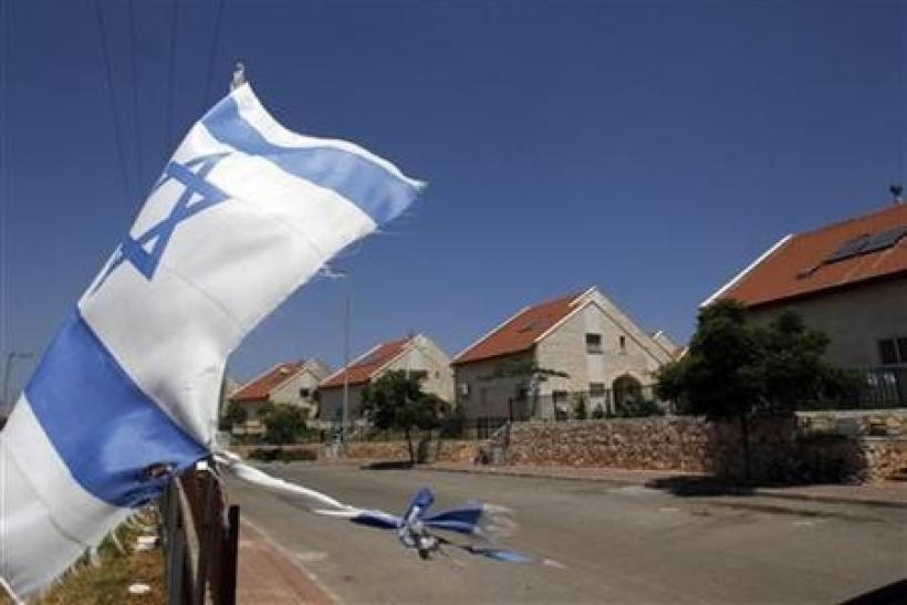 An Israeli flag waves in the West Bank Jewish settlement of Ofra