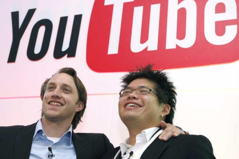 Chad Hurley and Steve Chen, co-founders of YouTube, pose after a news conference