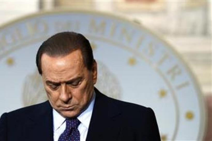 Italy's PM Silvio Berlusconi bows his head during a news conference with Malta's PM Lawrence Gonzi in Rome