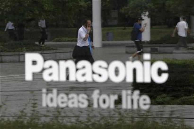 People are reflected on a sign at Panasonic Corp's showroom in Tokyo