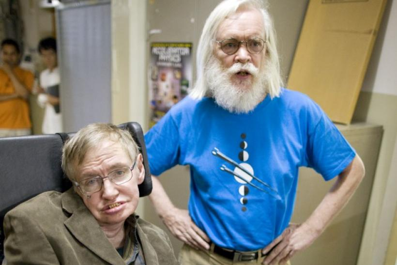 Theoretical physicists Stephen Hawking (L) and John Ellis.