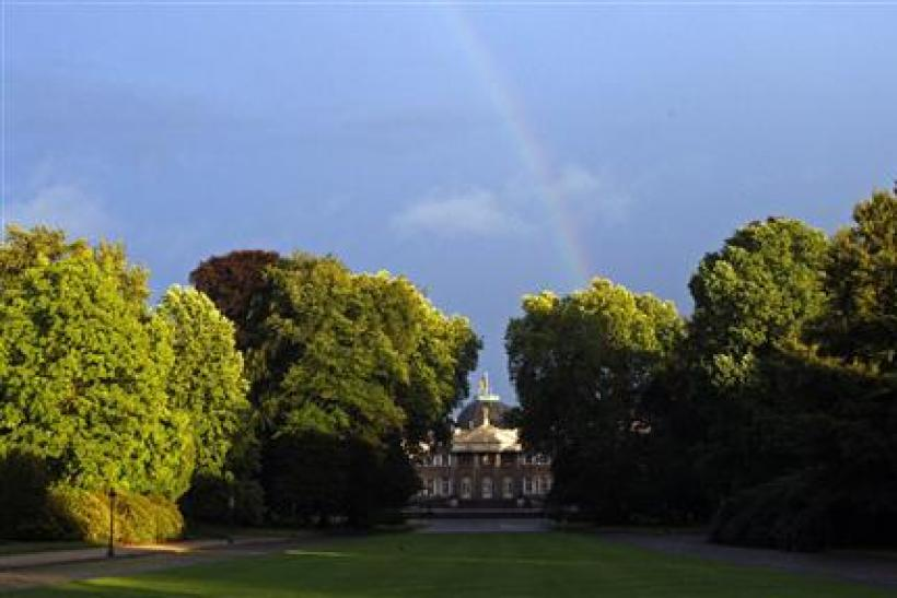 A rainbow is seen behind Laeken Royal Palace in Brussels