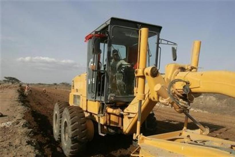 A engineer works at a road construction project near Isiolo town, 320 km (200 miles) north from the capital Nairobi