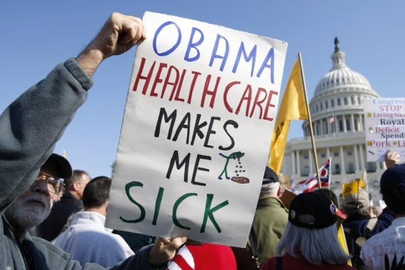 "A demonstrator holds up a sign during a ""House Call"" rally against proposed healthcare reform legislation at the Capitol in Washington November 5, 2009."