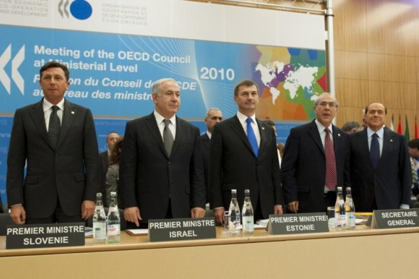 OECD Secretary General Gurria stands with prime minsters from Slovenia, Israel, Estonia, and Italy in this file photo.