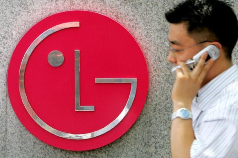 A South Korean walks past the logo of LG Electronics at its headquarters in Seoul