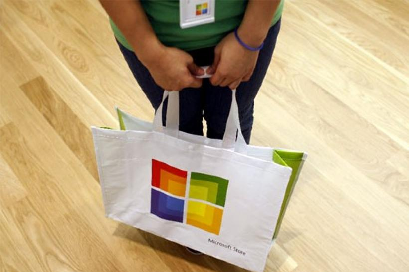 A worker holds a bag during the grand opening of Microsoft's first retail store in Scottsdale, Arizona