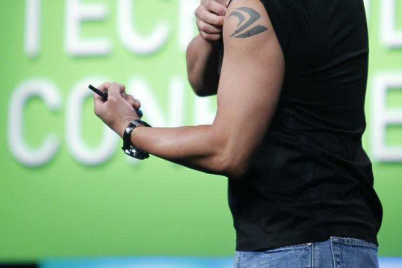 NVIDIA President and CEO Jen-Hsun Huang displays a tattoo during his keynote address at the GPU Technology Conference.
