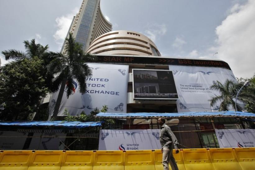 A man walks past the Bombay Stock Exchange (BSE) building in Mumbai September 21, 2010.