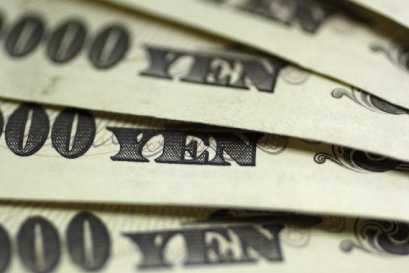 Japanese 10,000 yen notes are spread out at Interbank Inc. money exchange in Tokyo