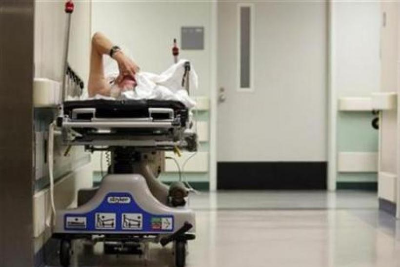 A patient waits in the hallway for a room to open up in the emergency room at Ben Taub General Hospital in Houston, Texas, July 27, 2009.