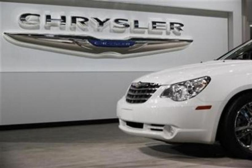 A Chrysler Sebring sits in front of the Chrysler logo at the New York International Auto Show in New York April 1, 2010.